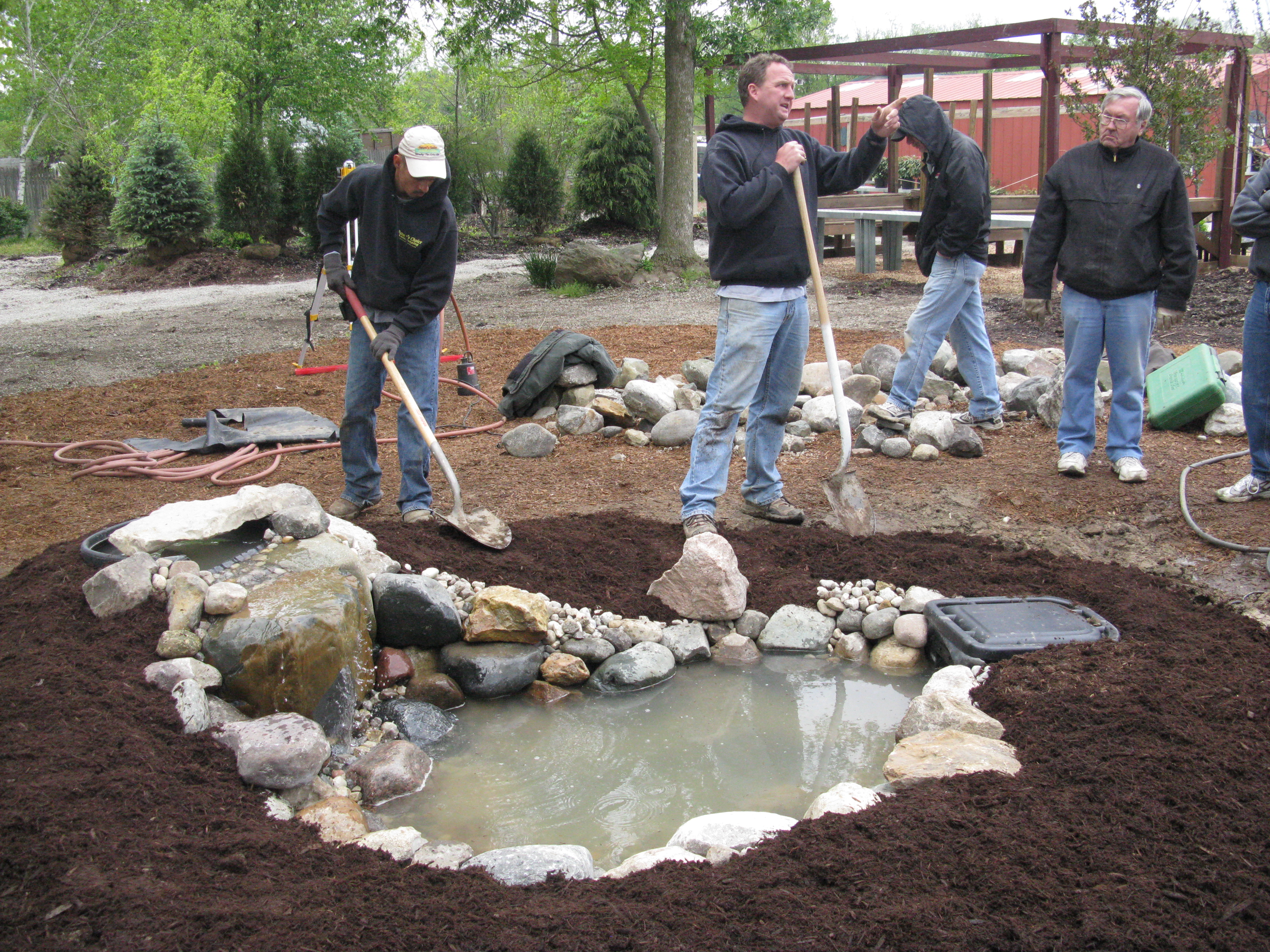 diyers with a hands on pond building experience